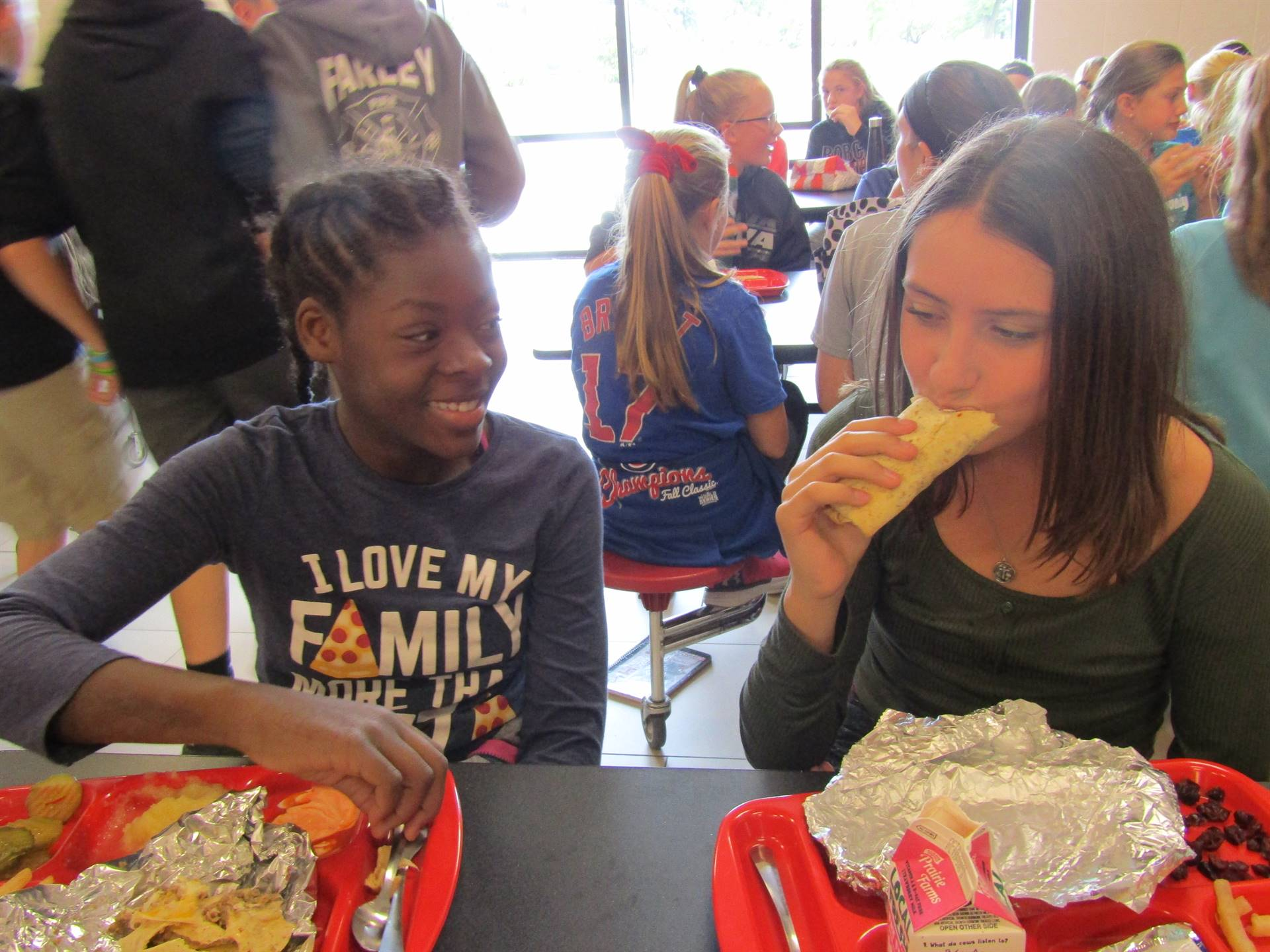 6th grade students enjoy lunch together
