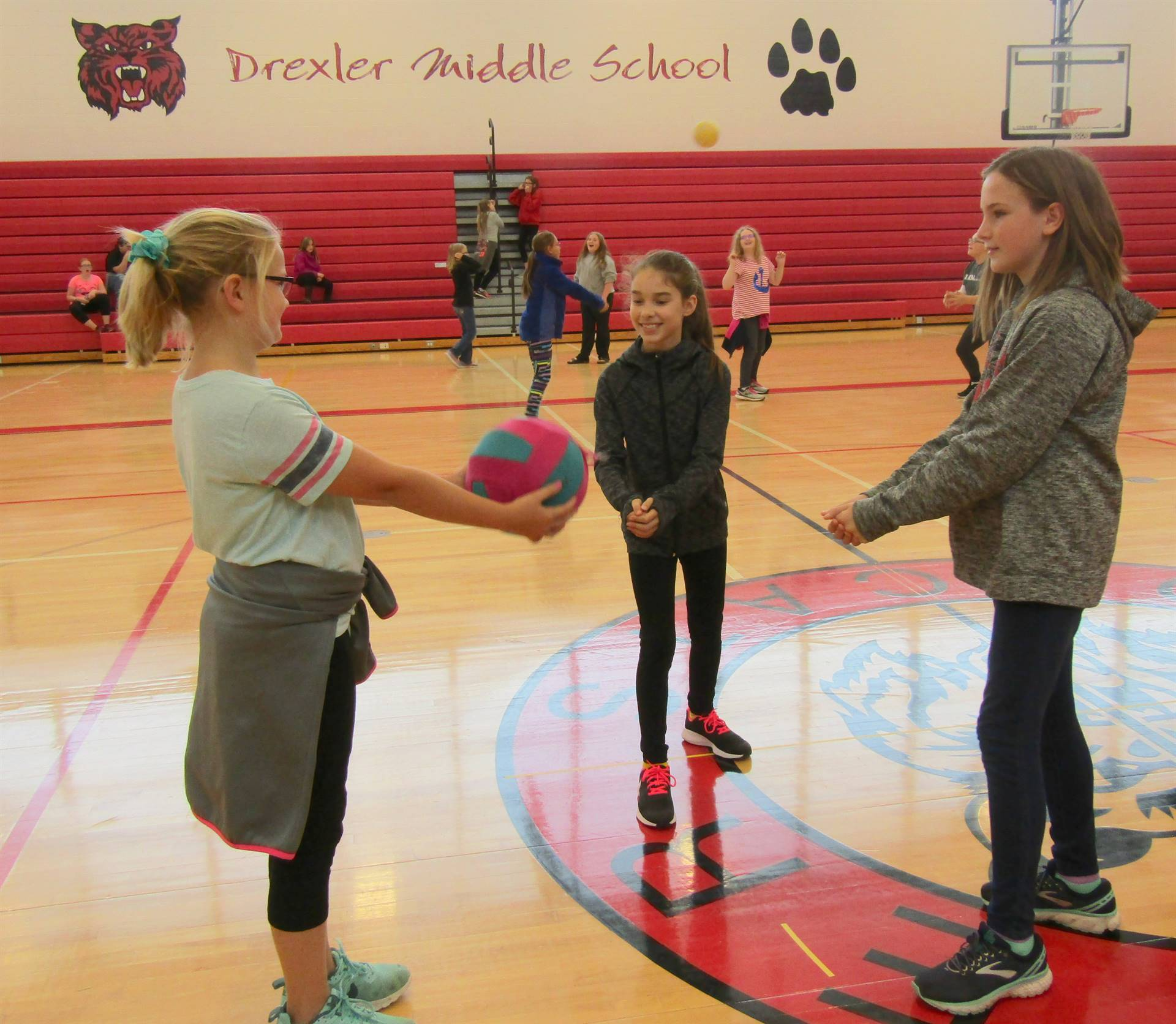6th graders practice volleyball techniques