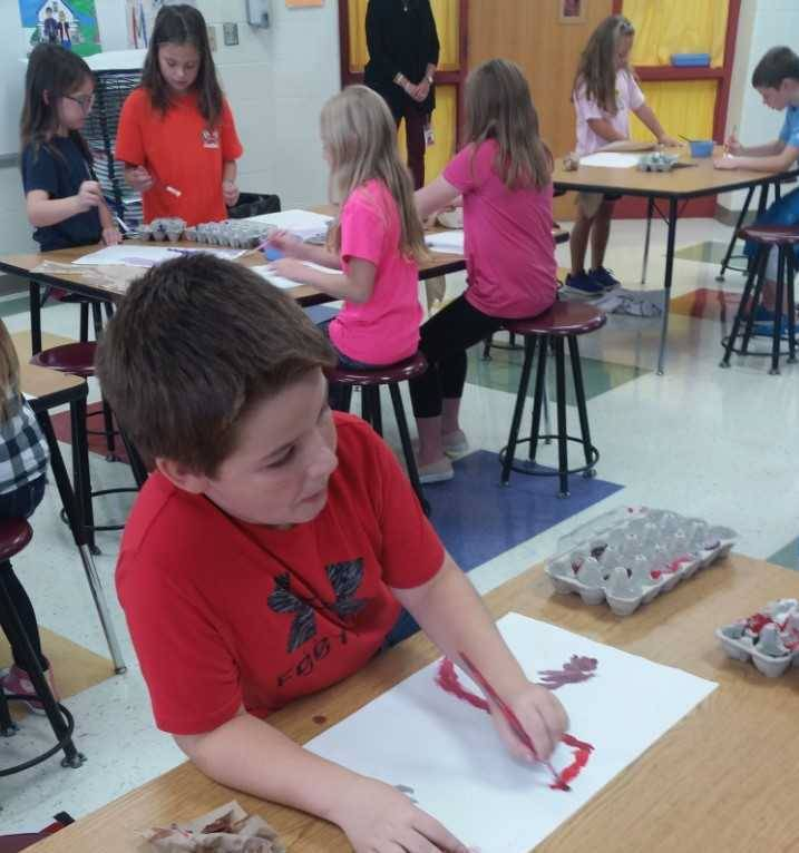 Elementary boy working on art project