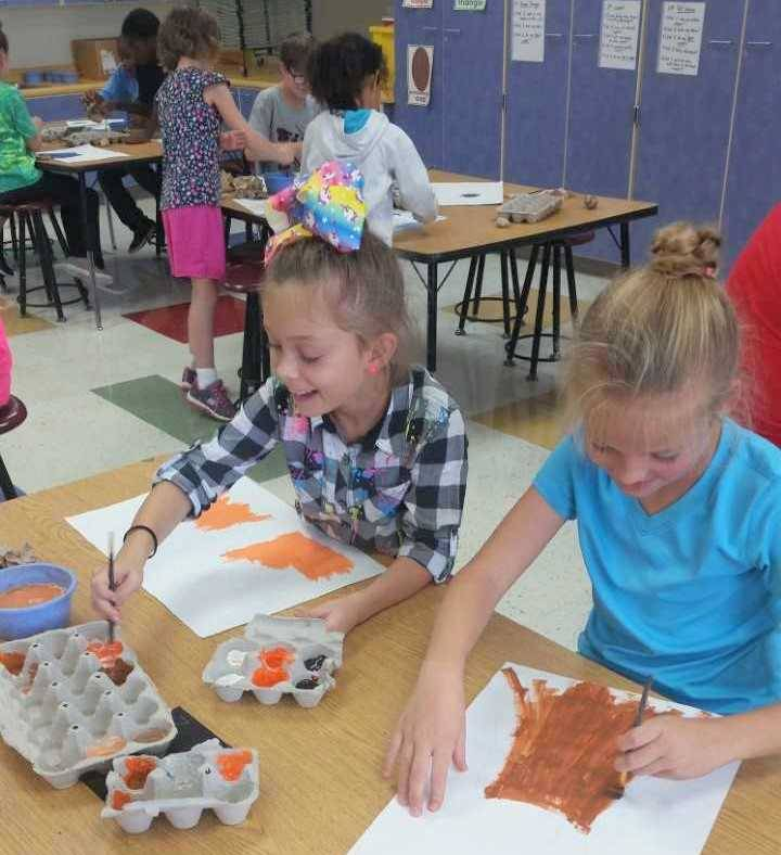 Elementary girls working on art project