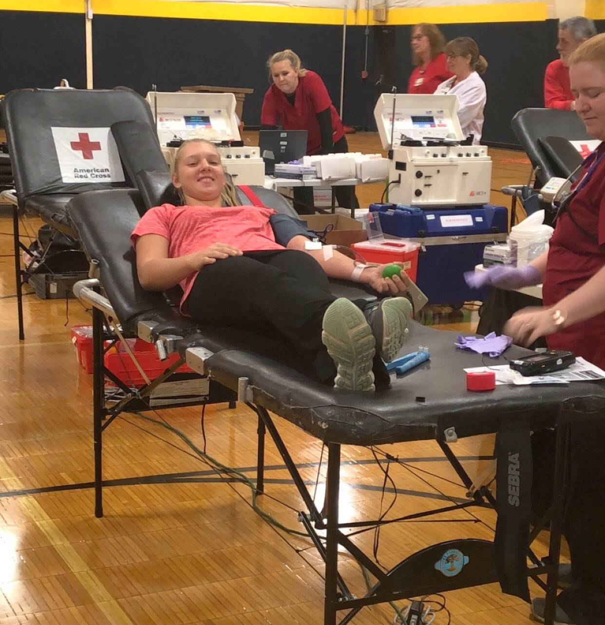 Student gives blood in annual blood drive