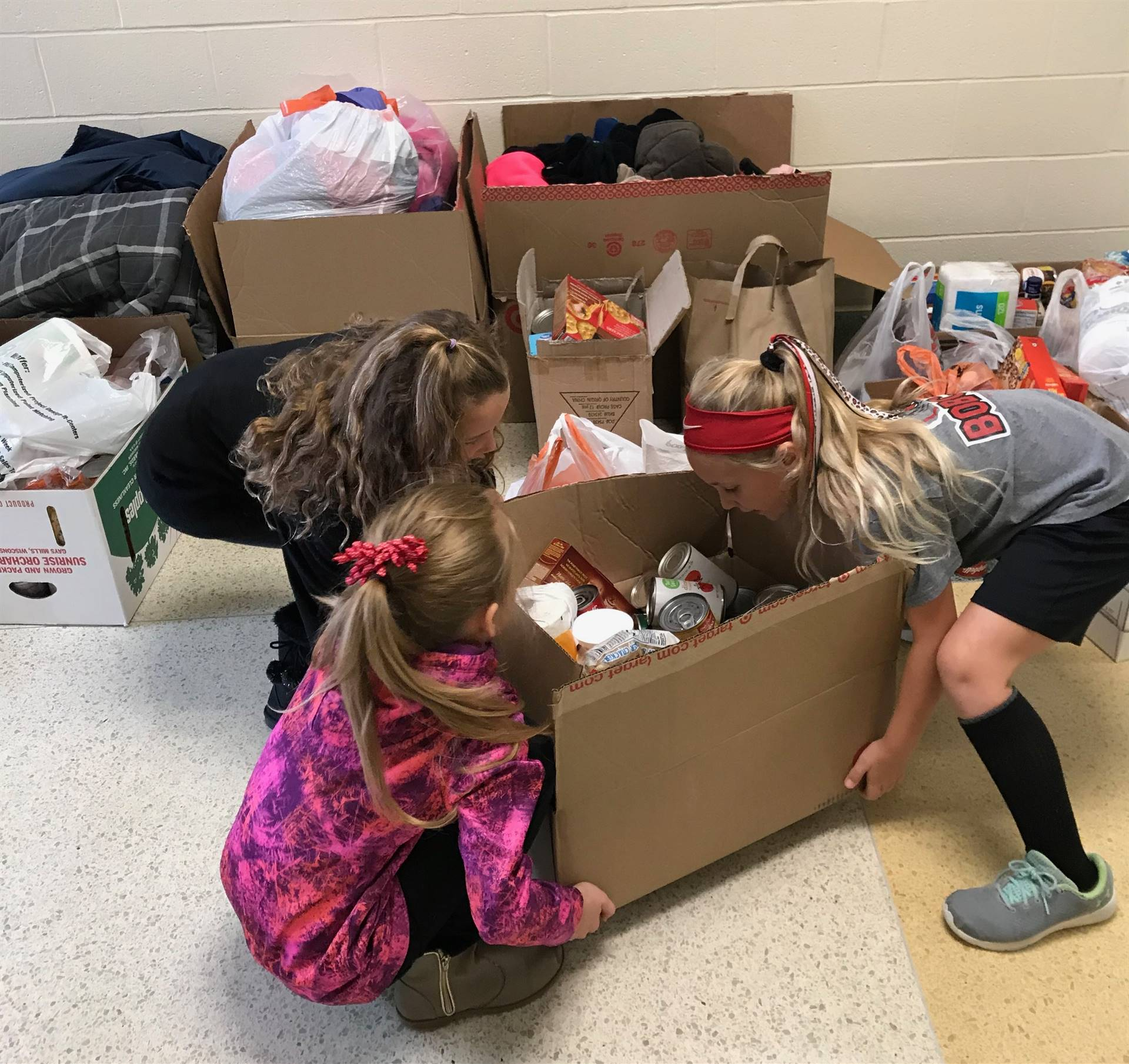 Elementary students assist with the annual food drive