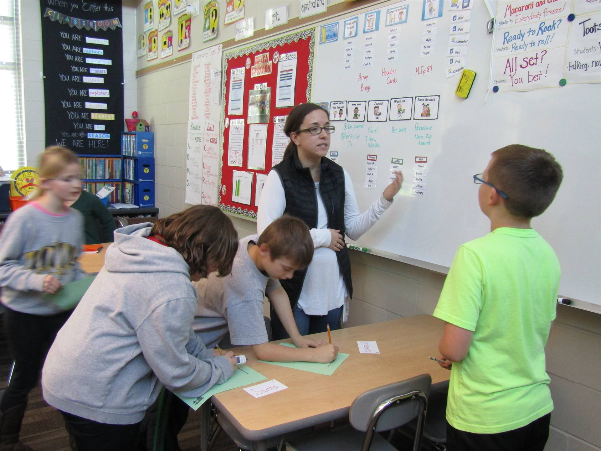A paraprofessional working with students