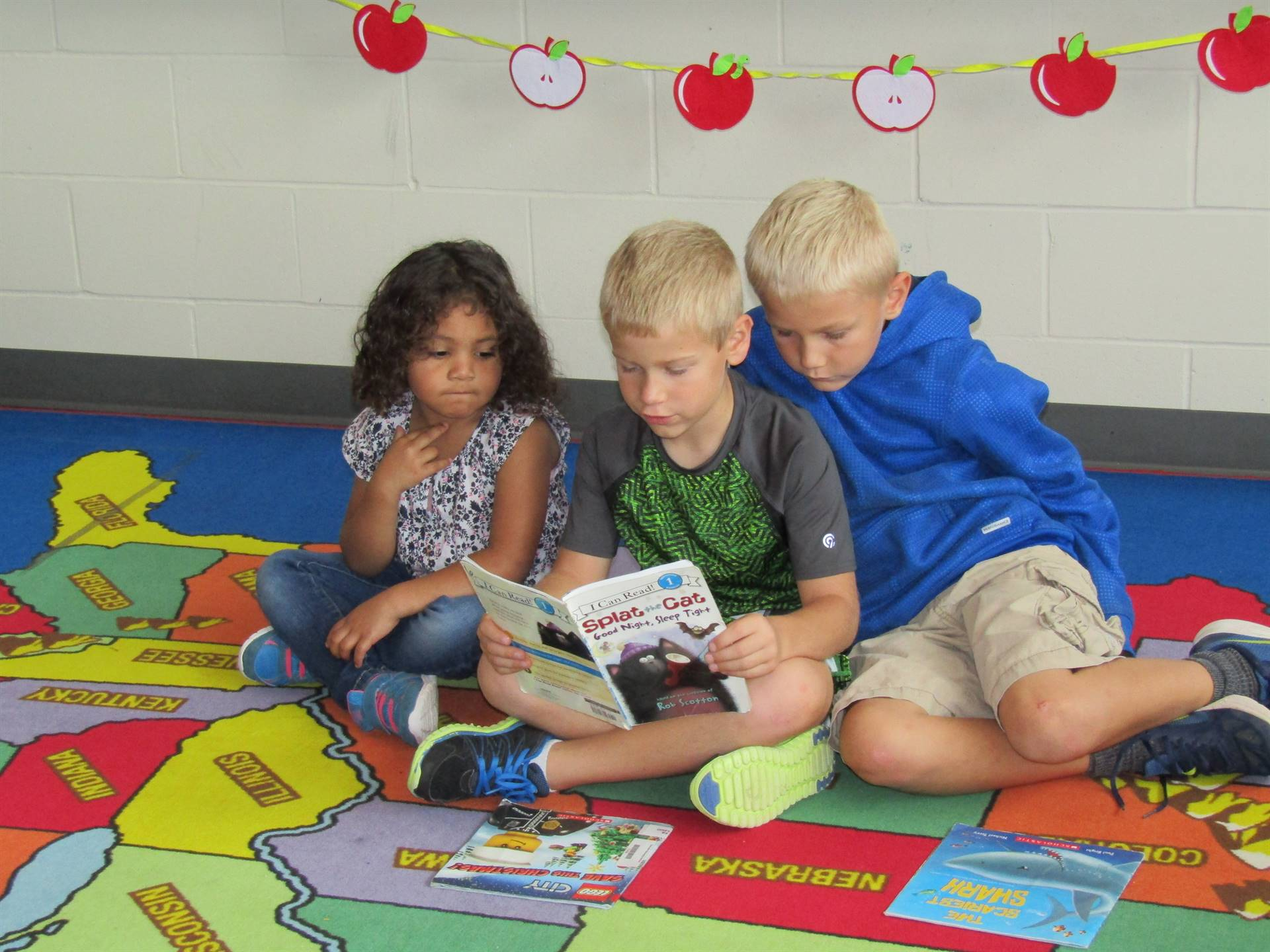 Students reading together during weekly Book Buddy Program