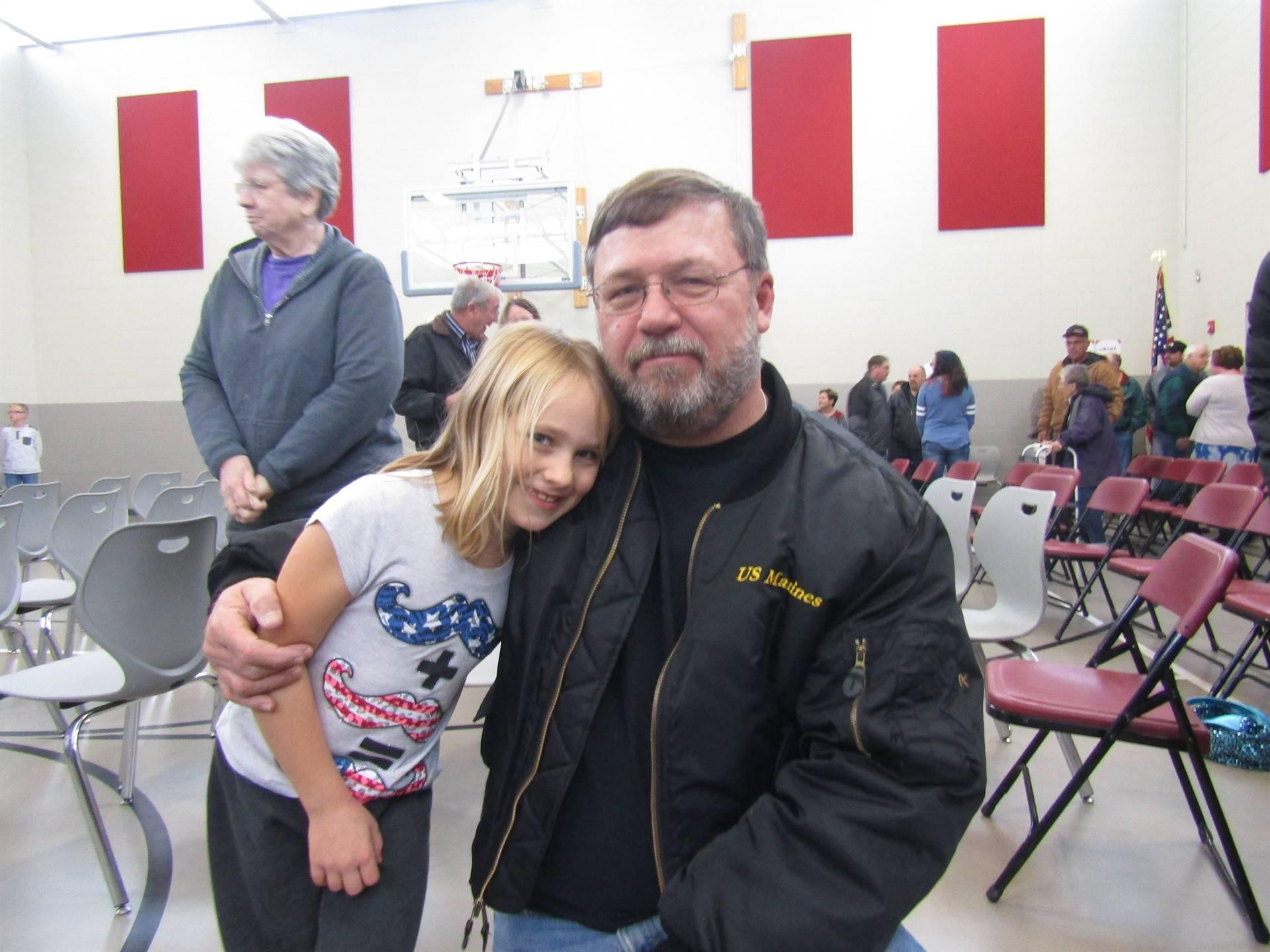 Student hugging her favorite veteran