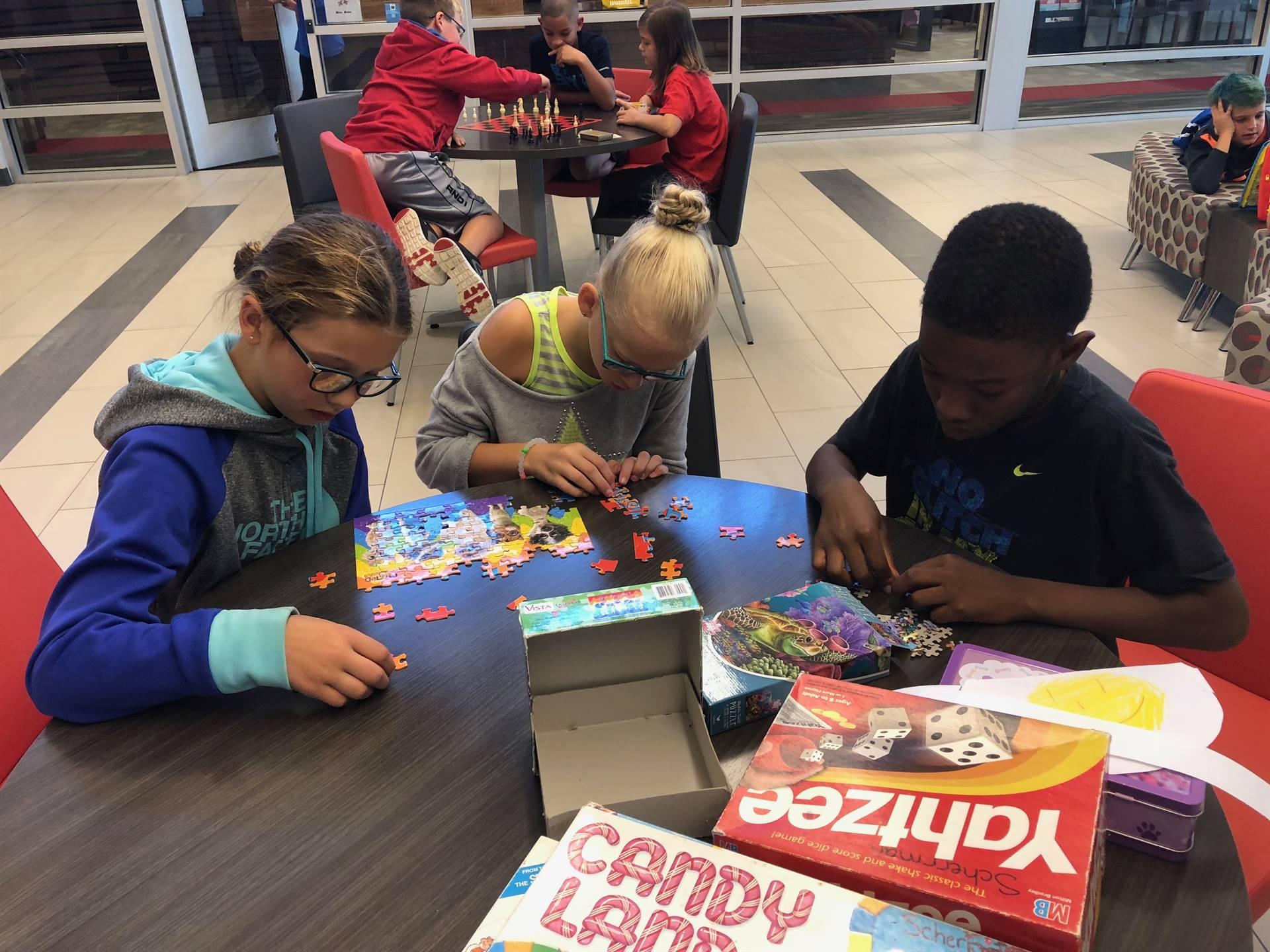 Students enjoying indoor recess games
