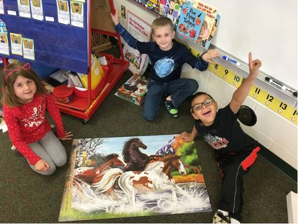 3 students with a puzzle