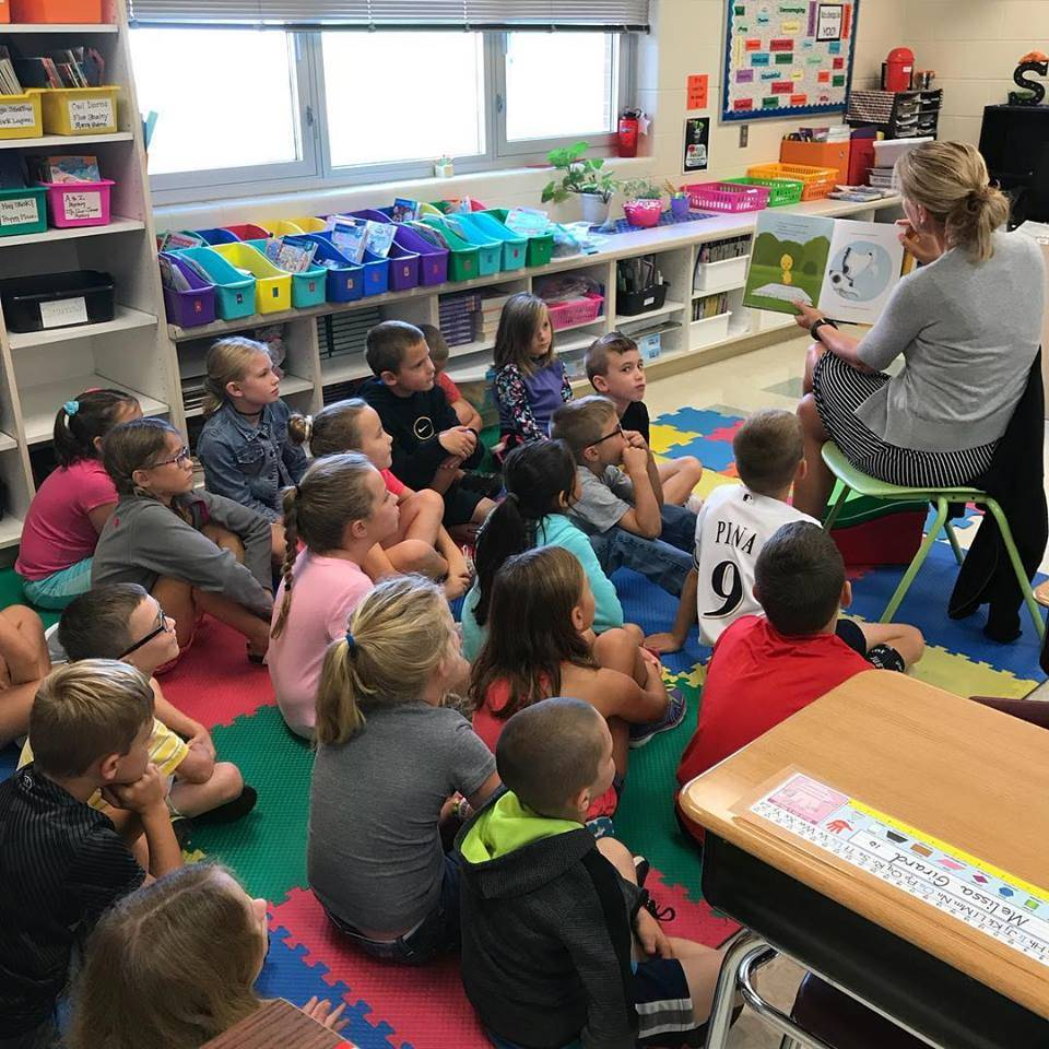 2nd graders listen to a read aloud story