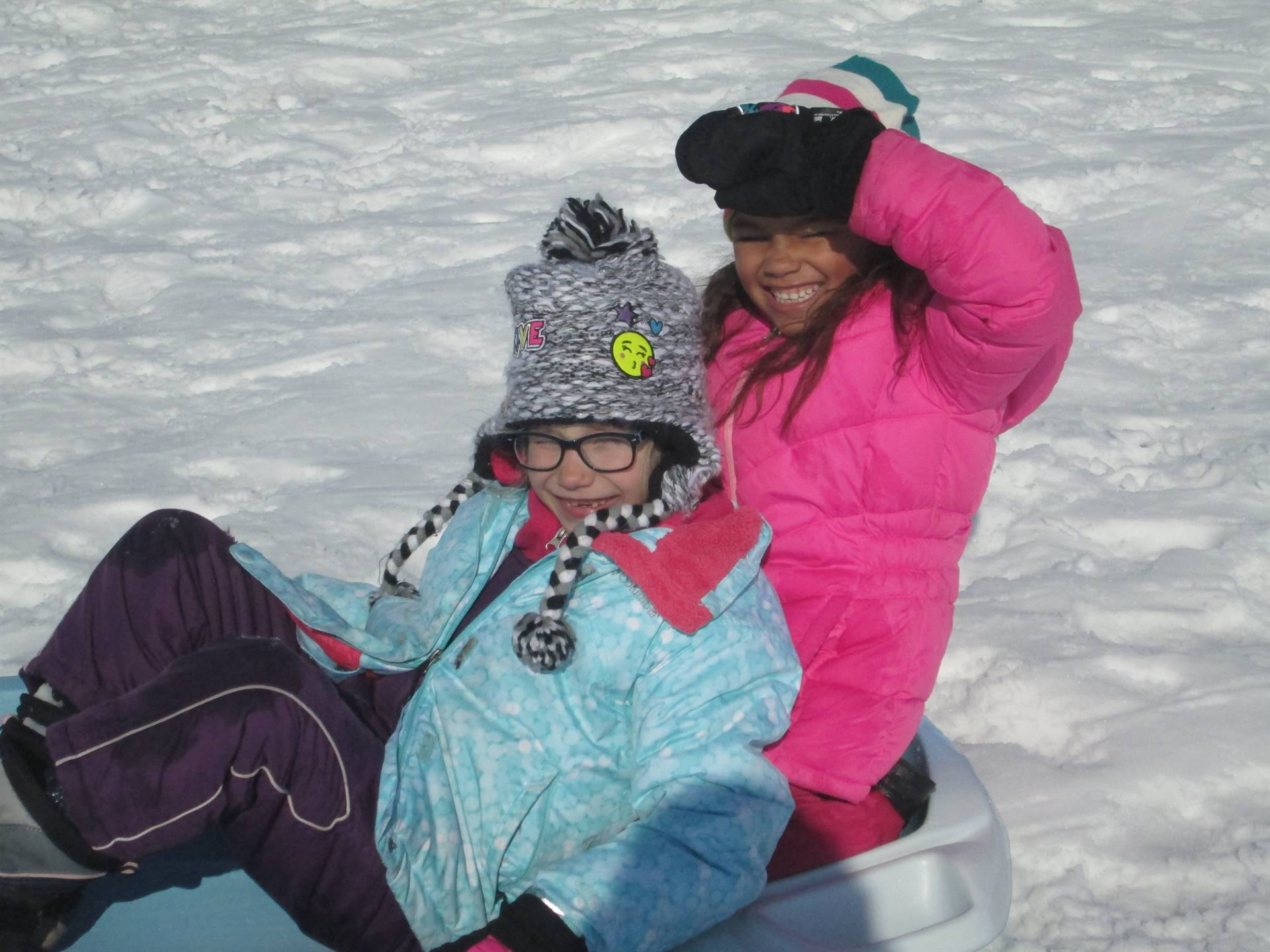 2 Girls sledding