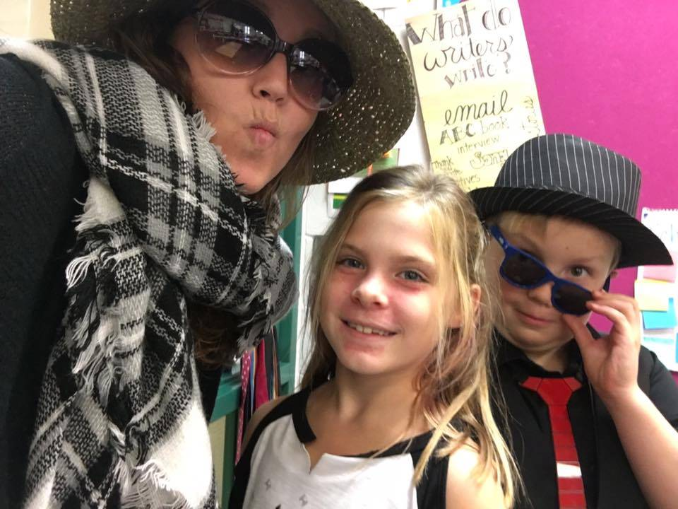 Teacher with a boy and a girl
