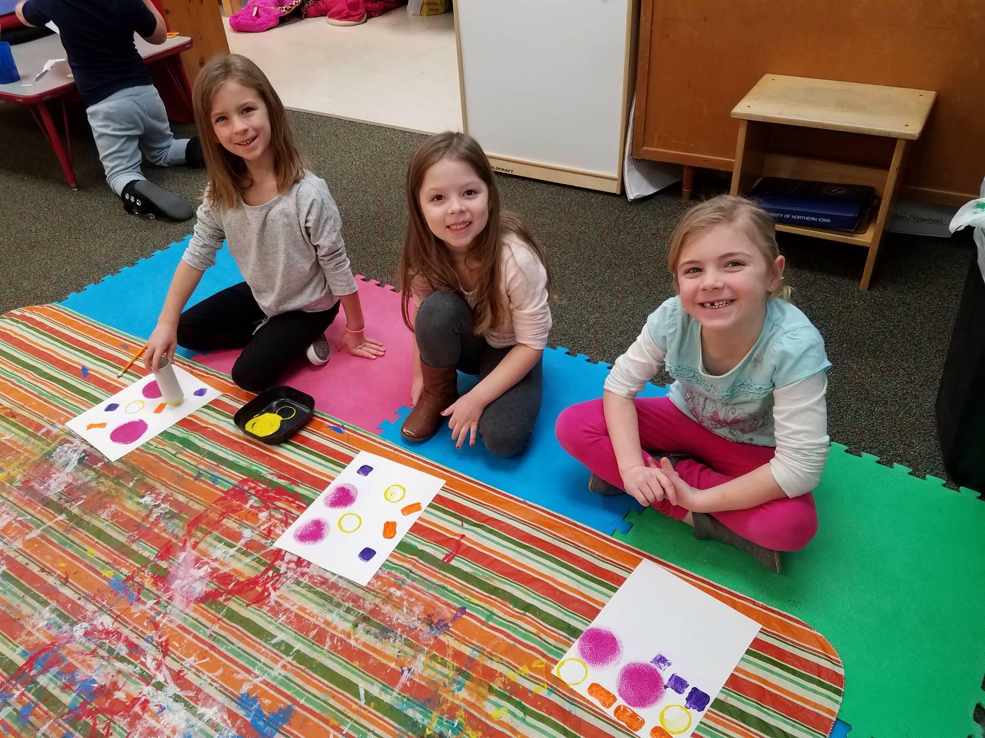 3 kids painting