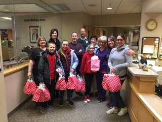 Middle School students deliver care packages to the Wendt Center