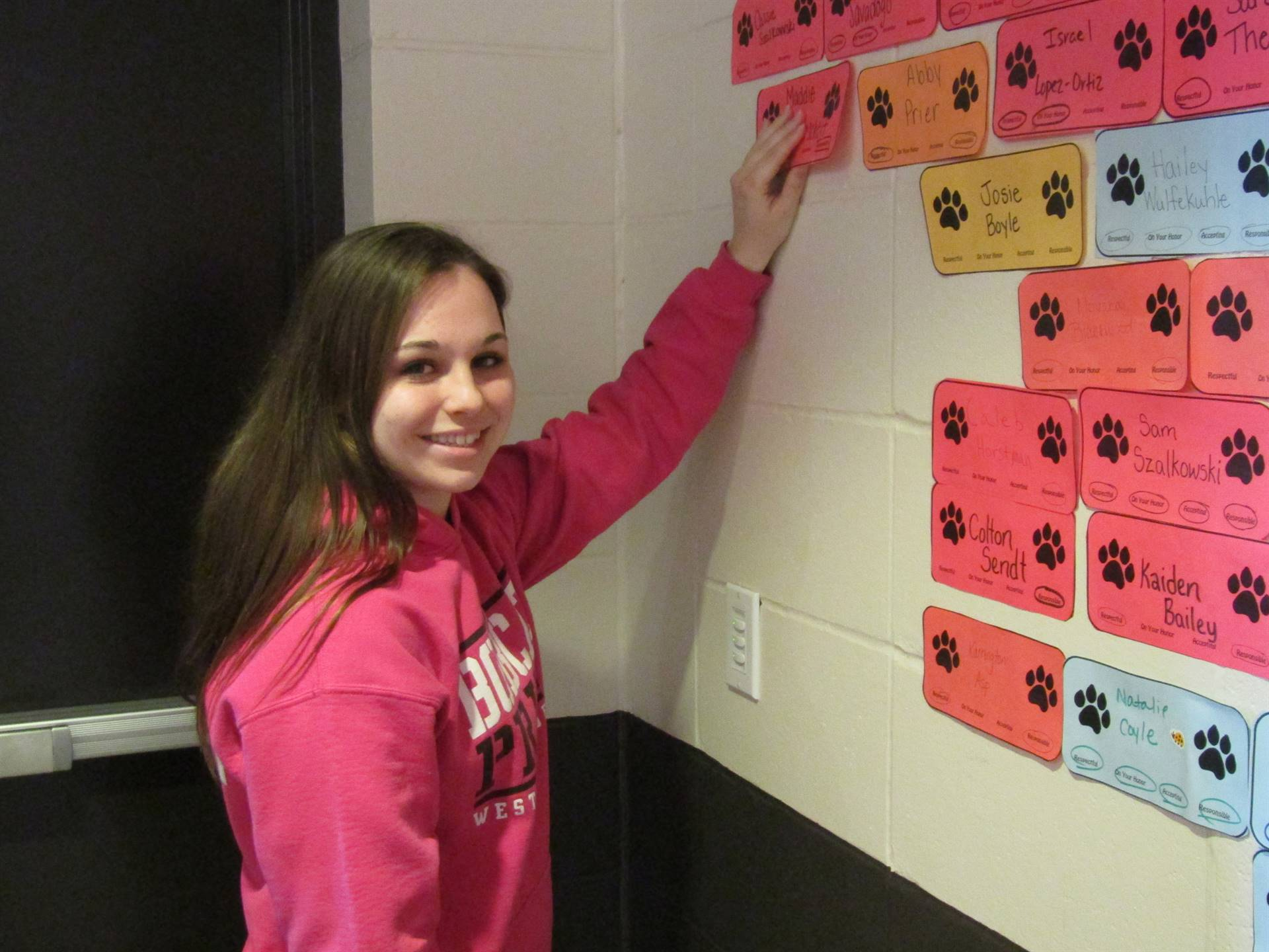 Wall of fame student hangs name on wall