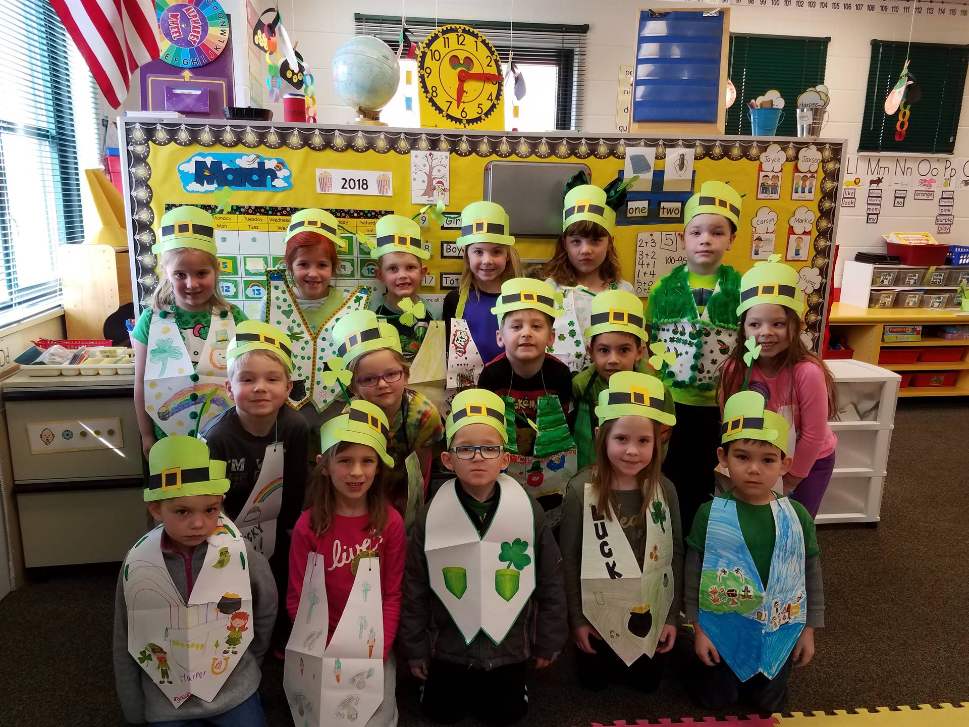 Kindergartners showing their green for St Patrick's Day