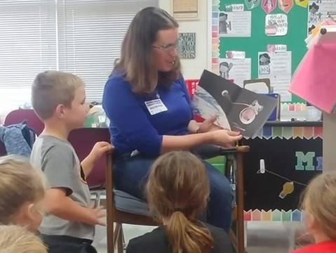 Parent reading to class