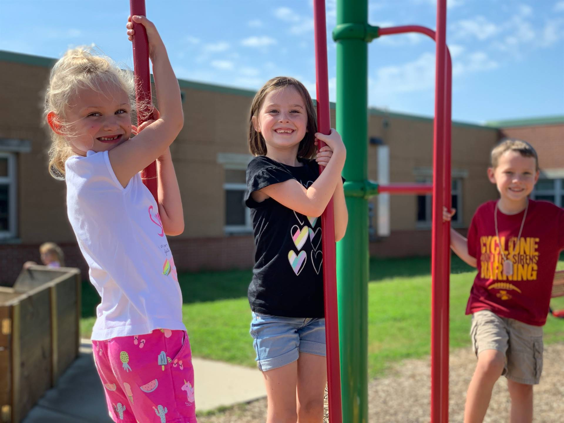 1st graders enjoy the sunshine on the EES playground