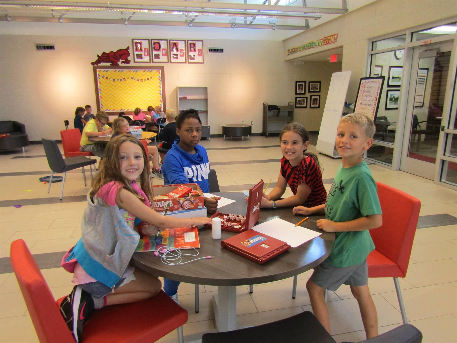 Students enjoying games at indoor recess