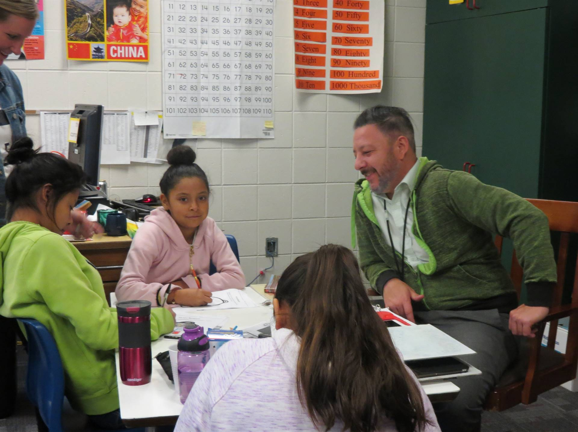 Interpreter working with students