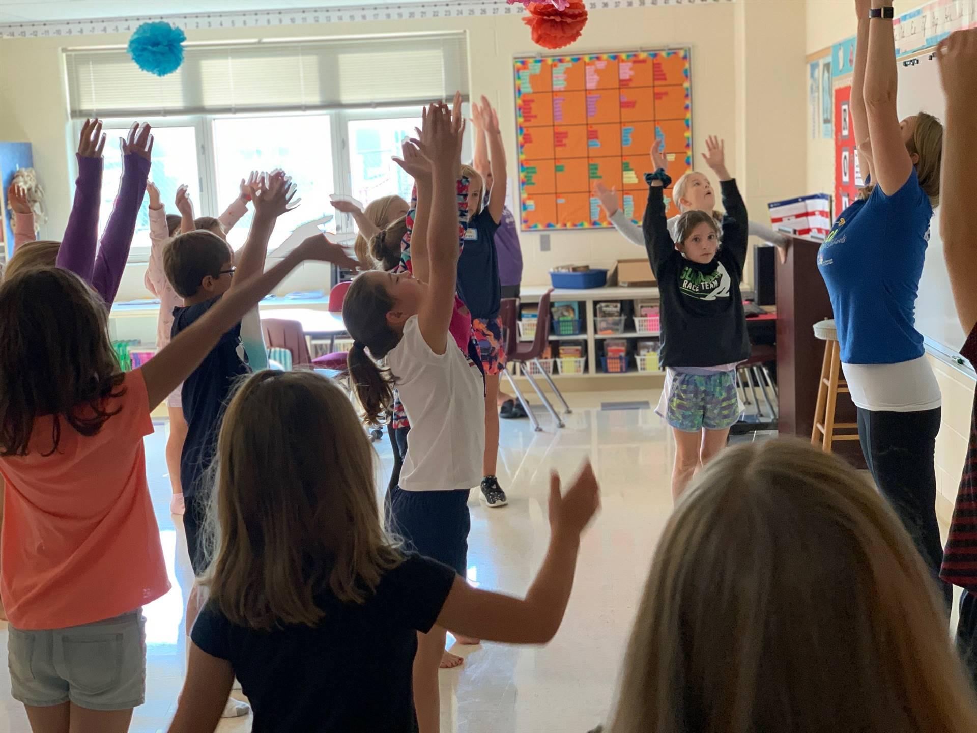 Students learning yoga