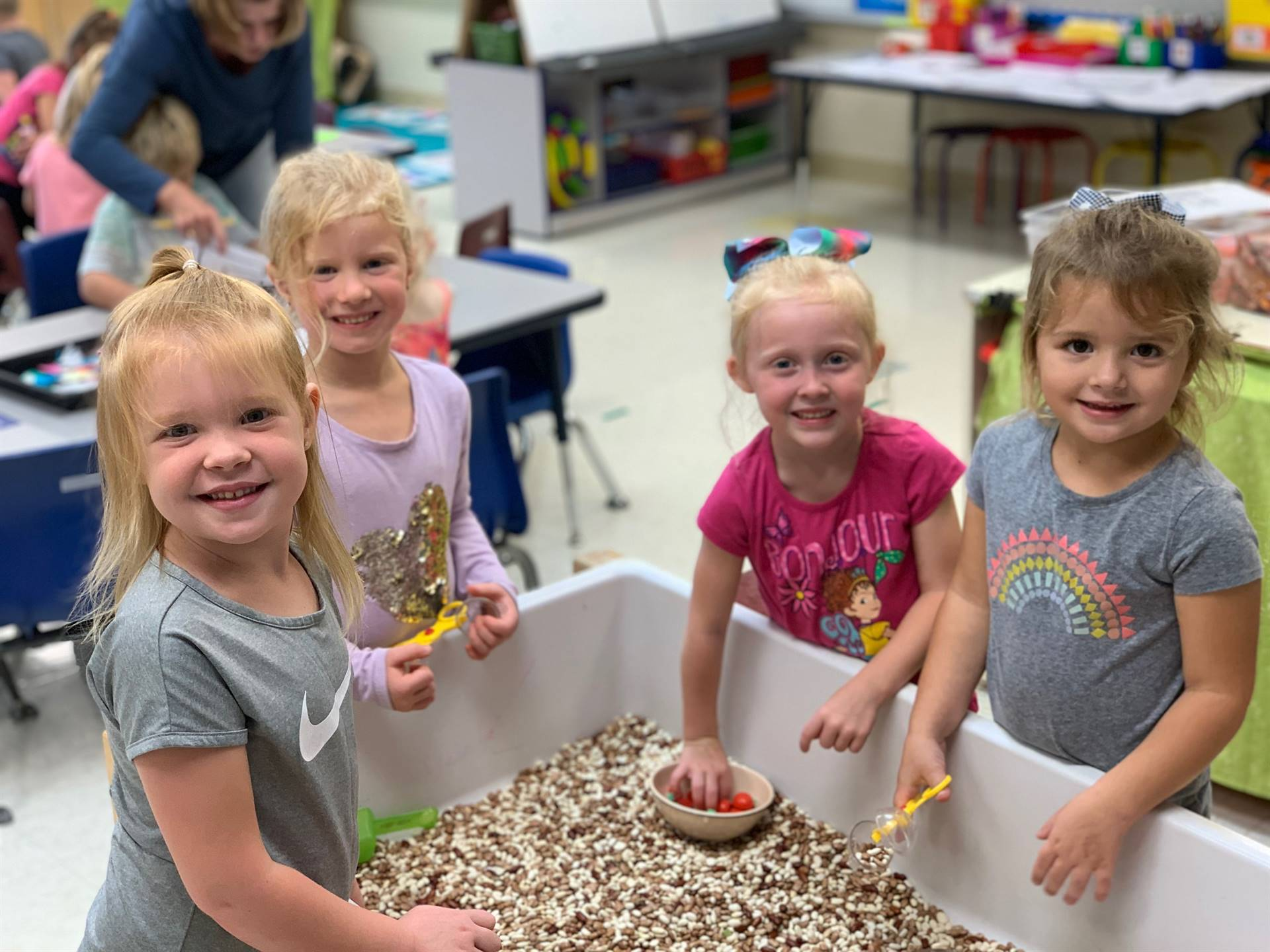 Preschoolers exploring with the sensory table