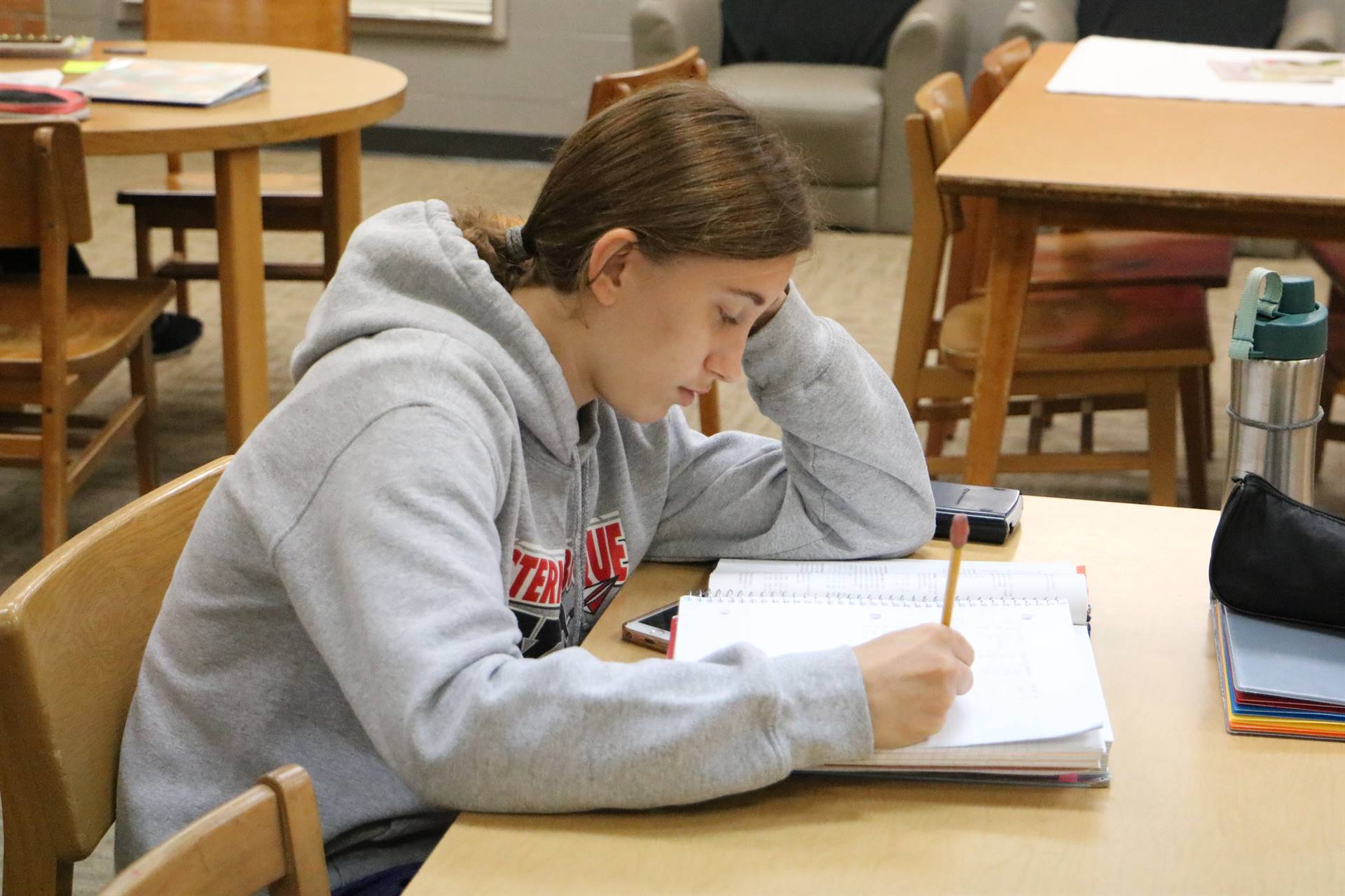 High student working in the library