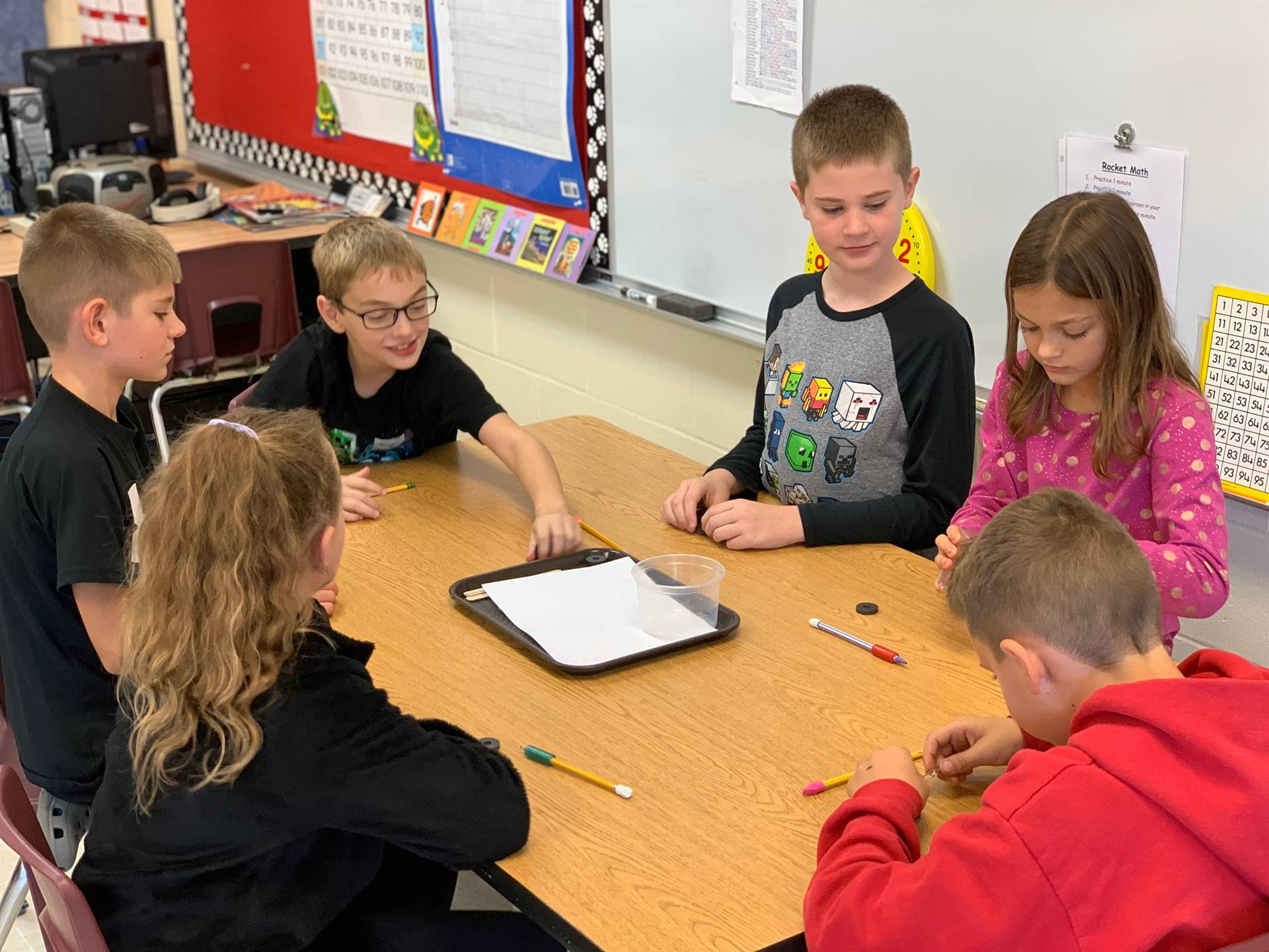 Elementary students exploring magnetism in science class