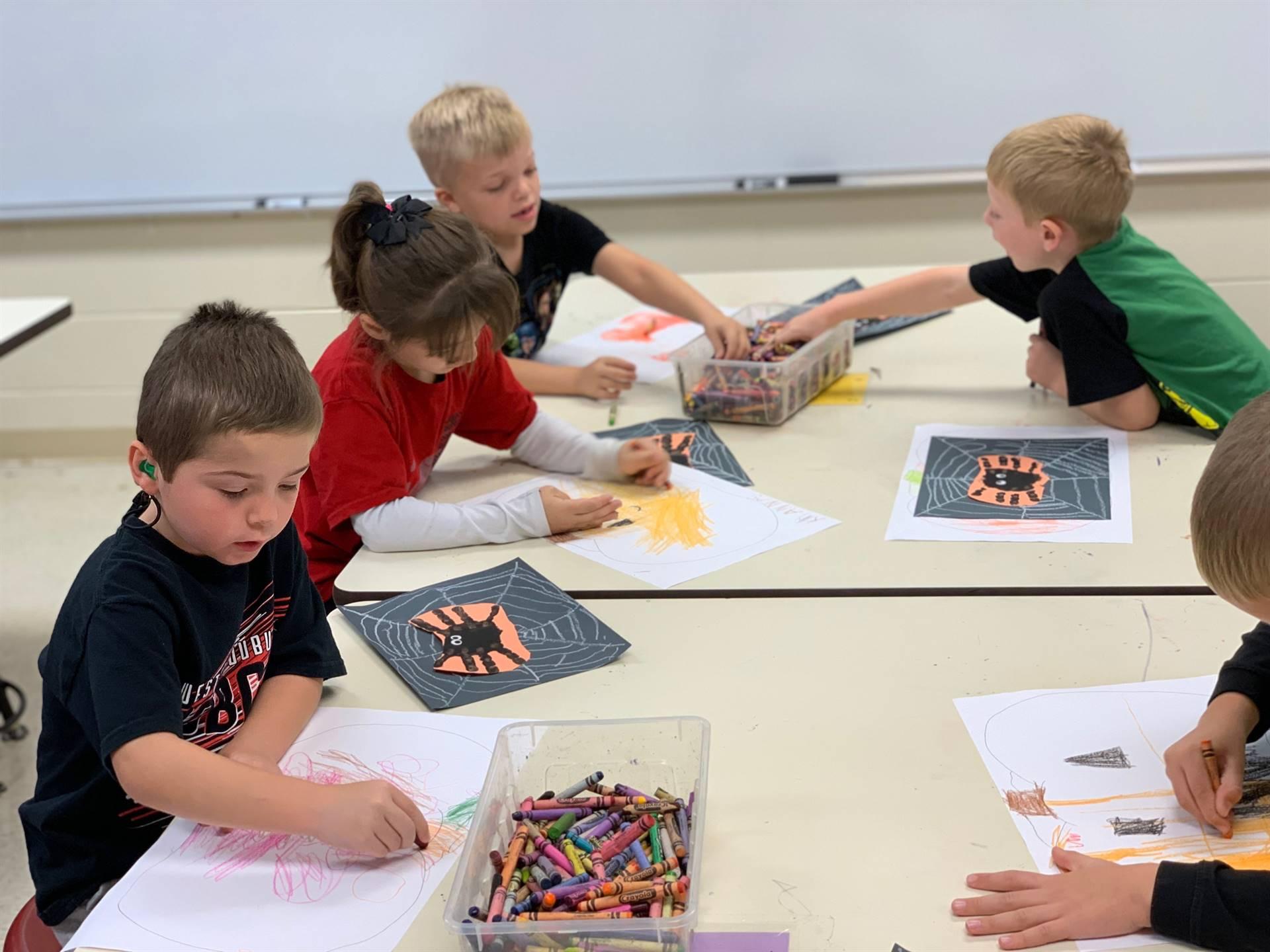 Kindergarten students working on art project