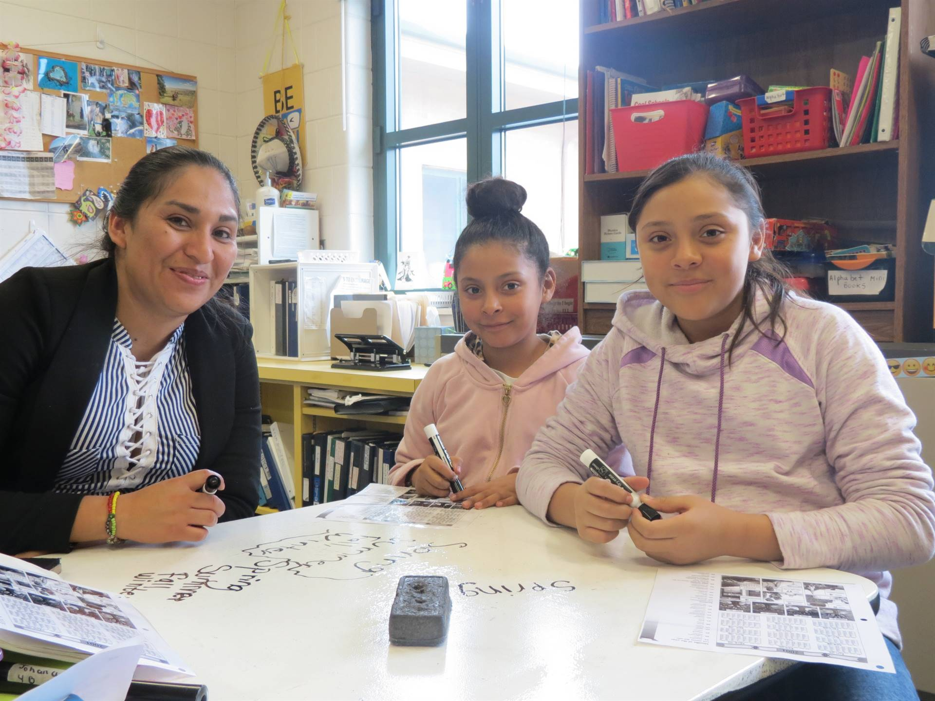ELL interpreter working with students