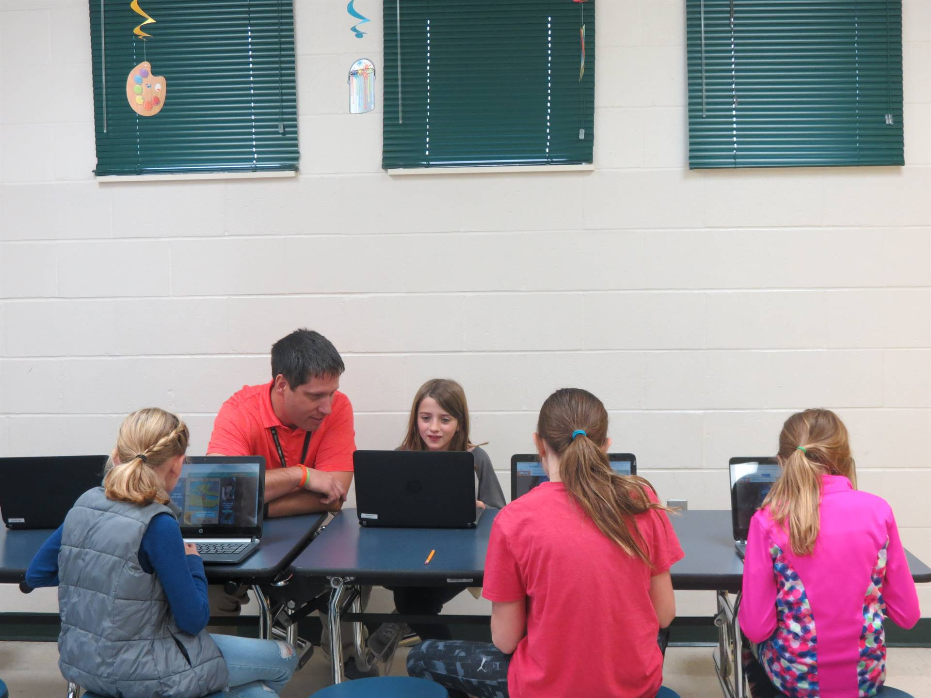 Technology Teacher Leader working with students