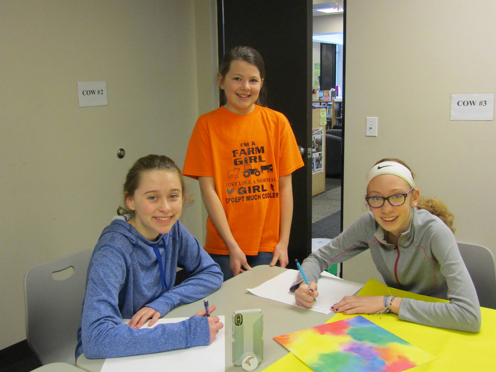 middle school students create posters of positivity