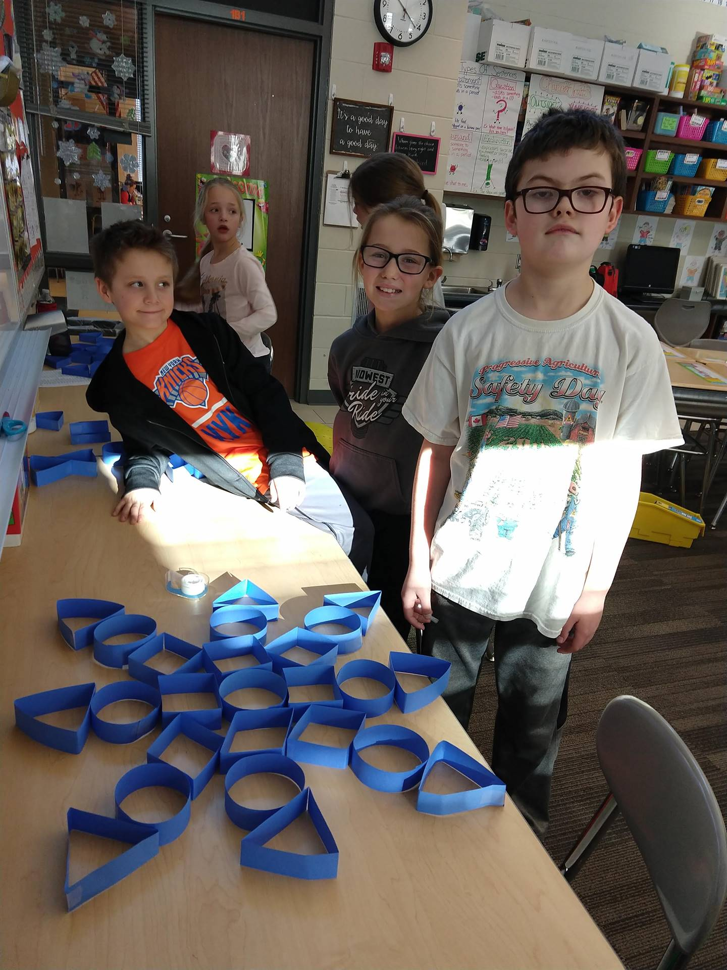 Students showing a paper creation.