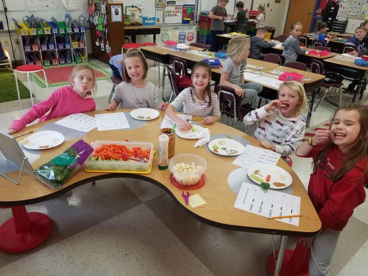 1st Grade Girls eating Veggies