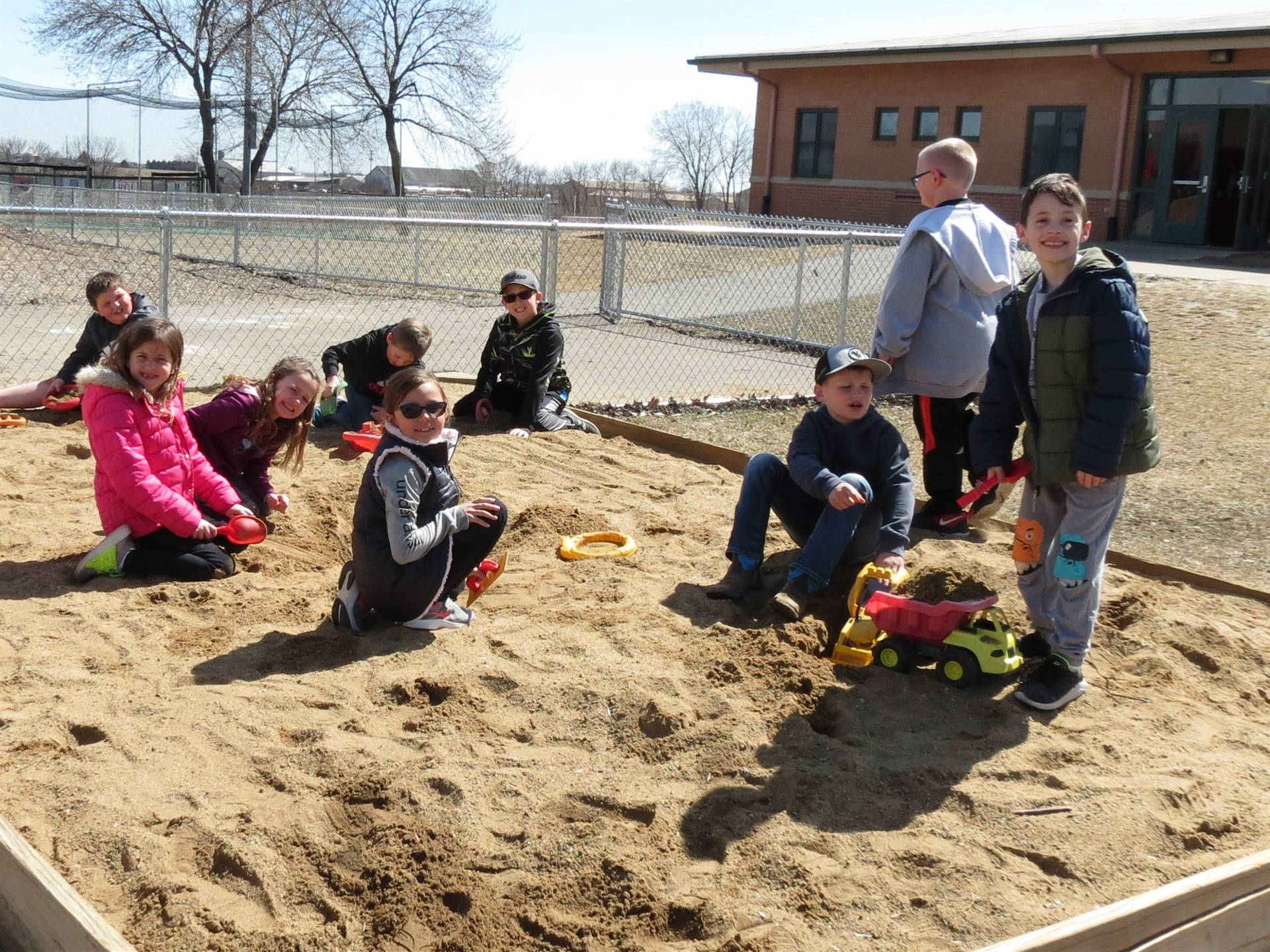 group of students in sandbox