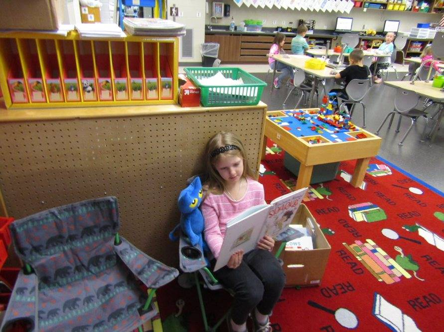 "Student reading to ""Pete the Cat"""