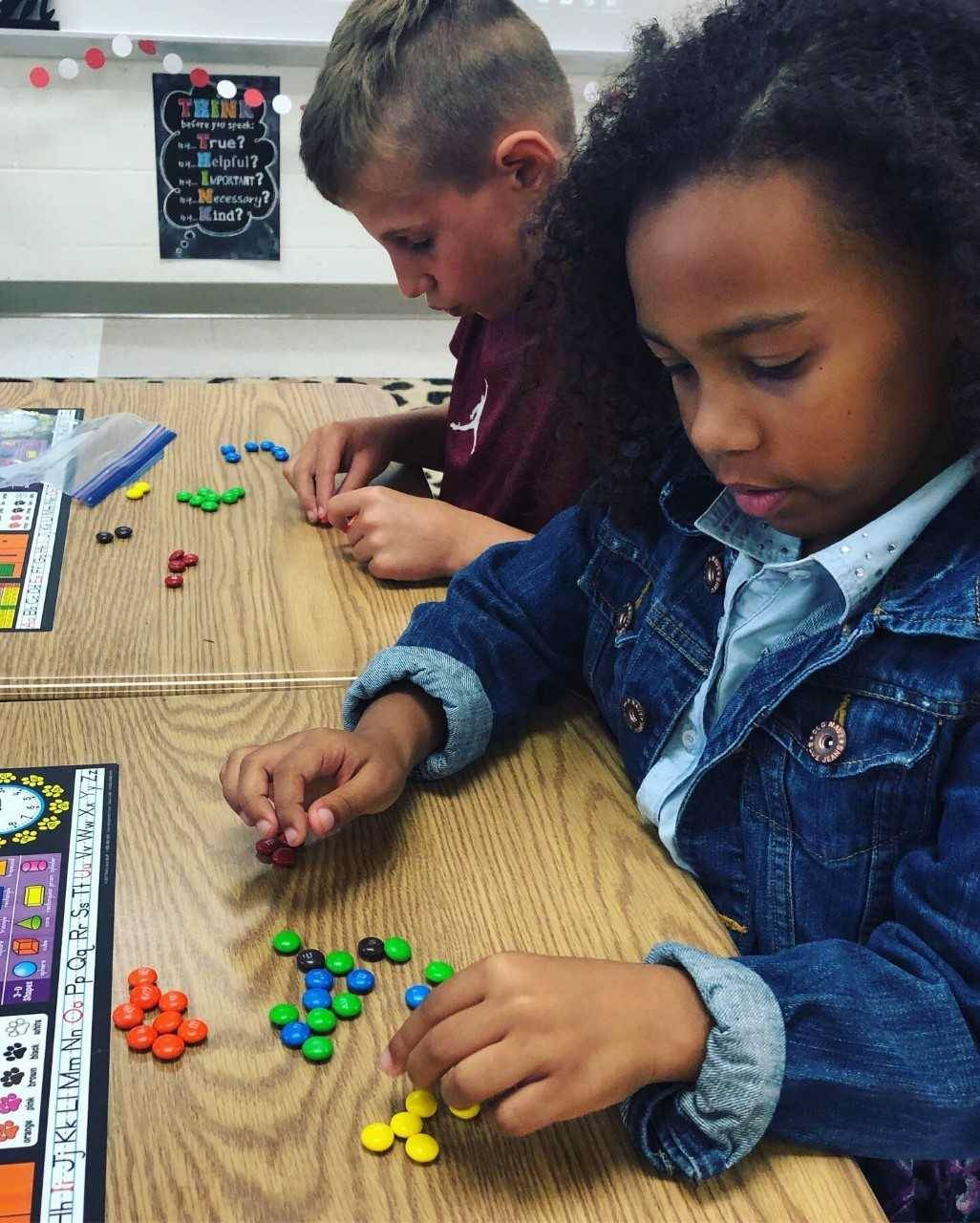 students sorting m and ms
