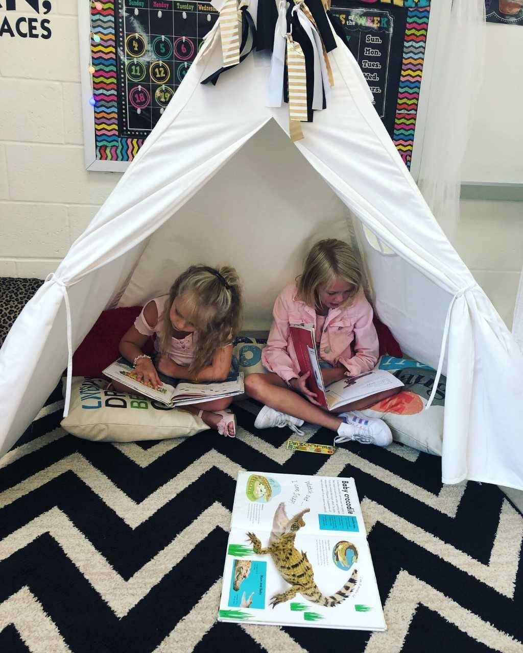 2nd grade girls reading in a tent