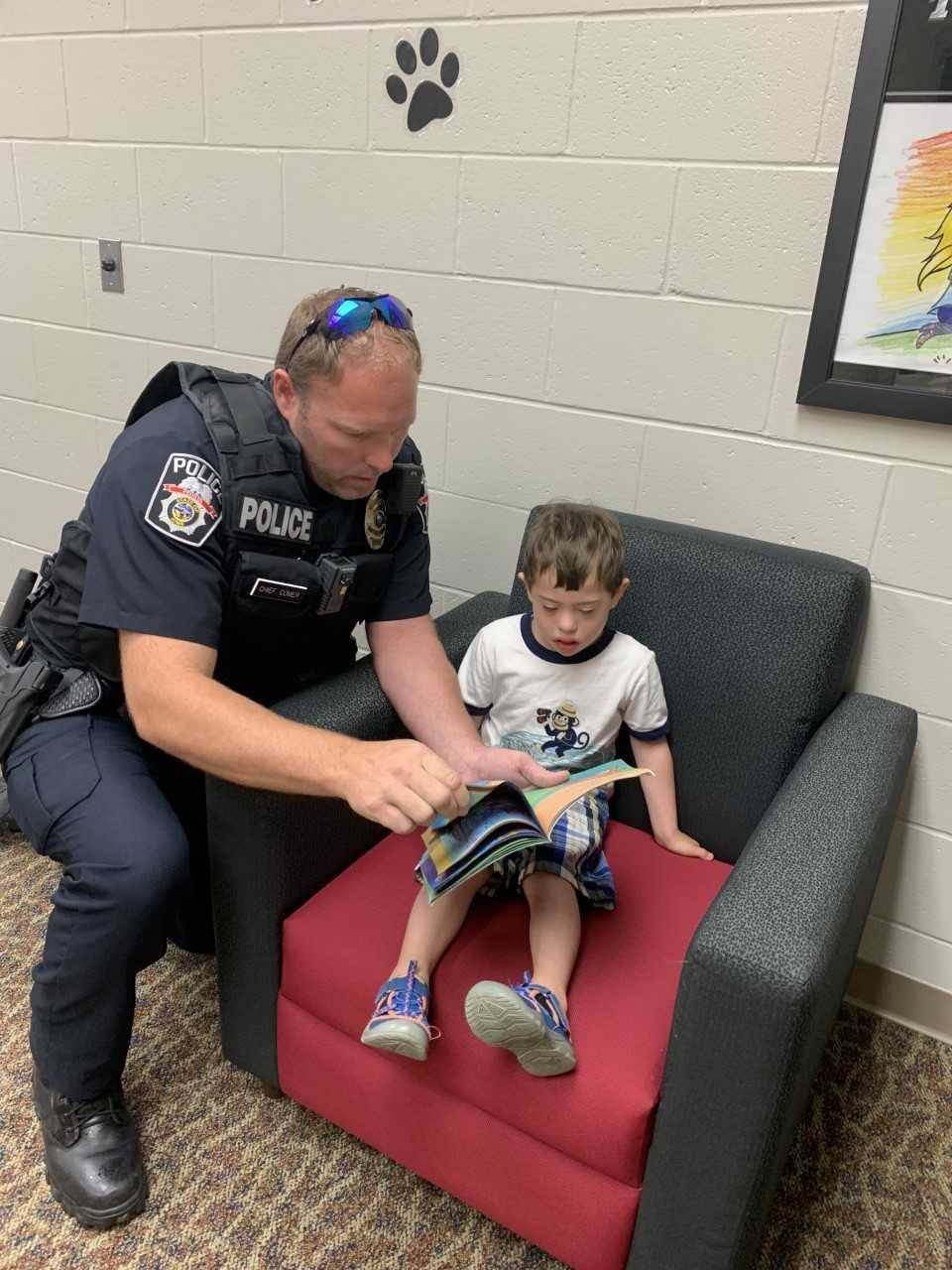 Chief of police reading with student
