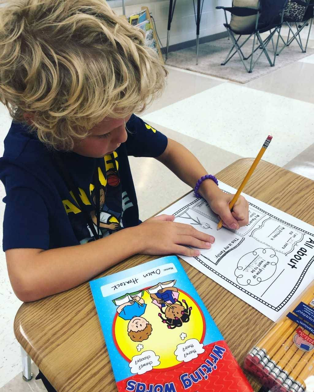 Second grade boy working on project