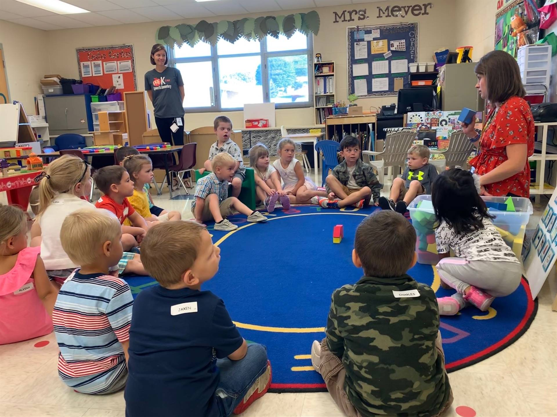 Mrs. Meyer leading her preschool students