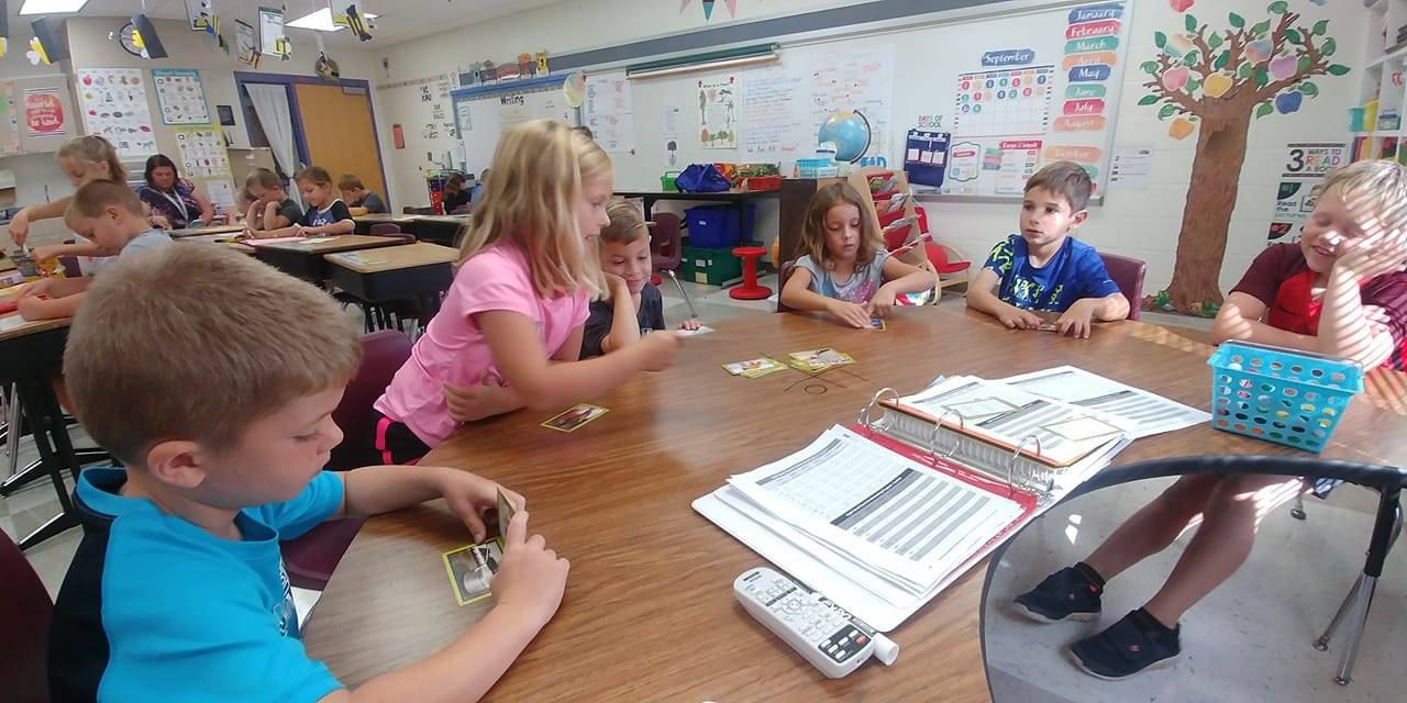 First grade students working at table