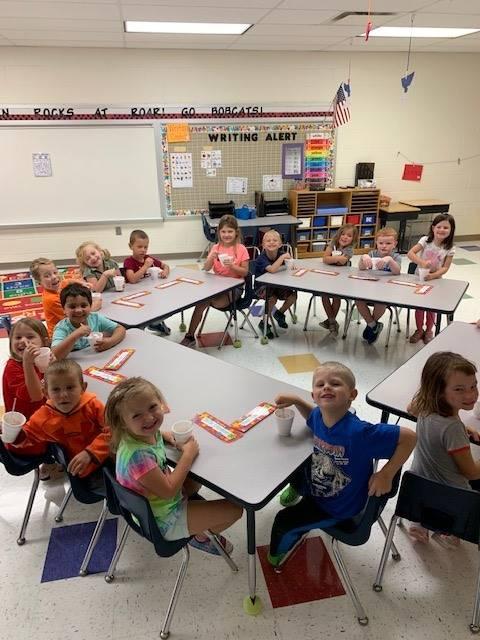 Kindergarten students with homemade applesauce
