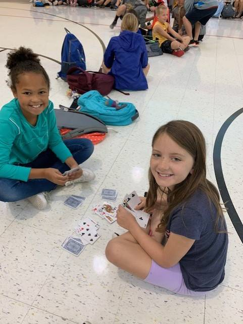 4th grade girls playing cards in the gym