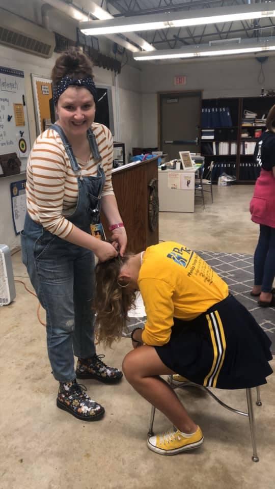 Braiding hair during Homecoming