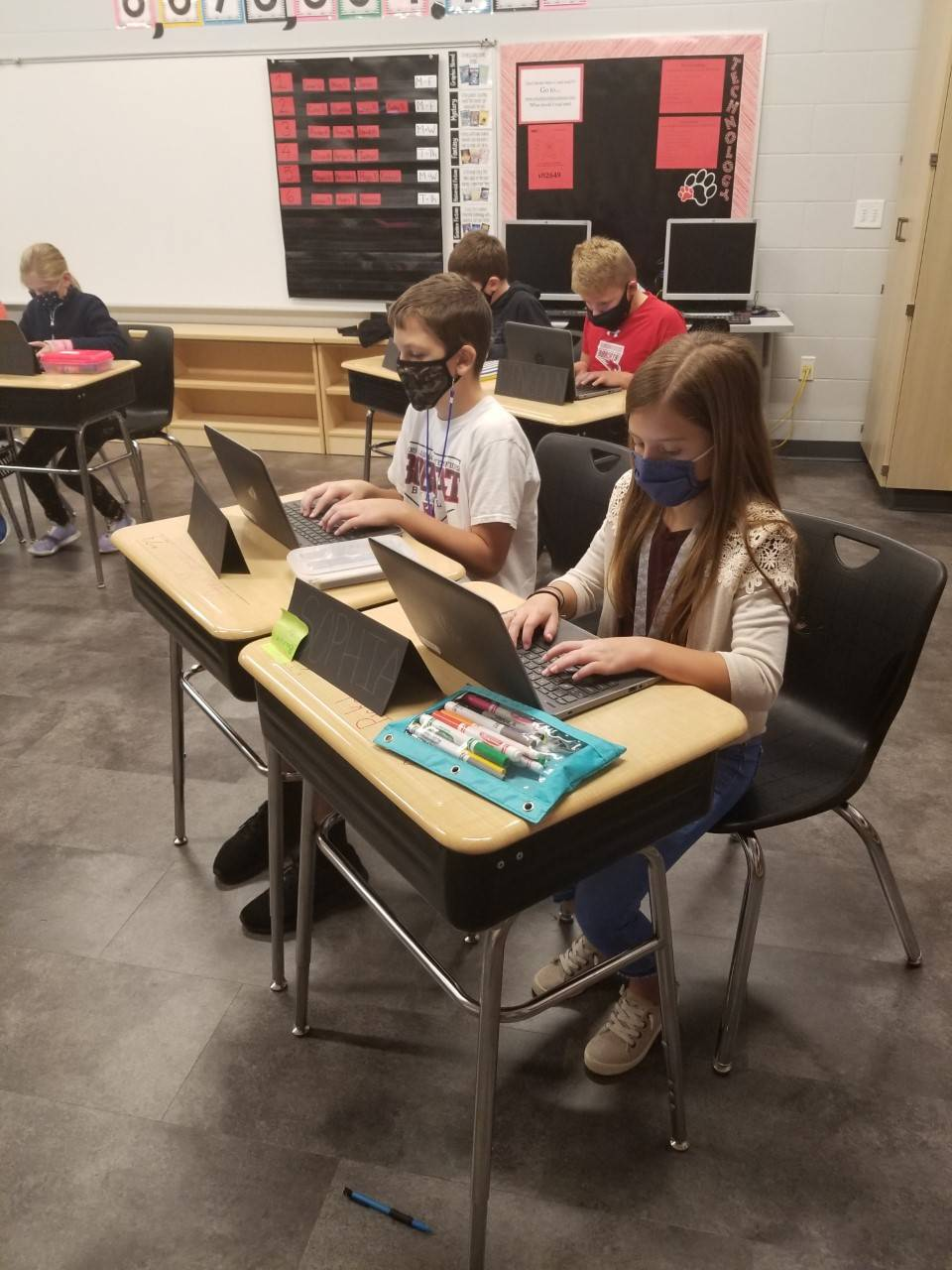 Two 5th grade students using lap top computers
