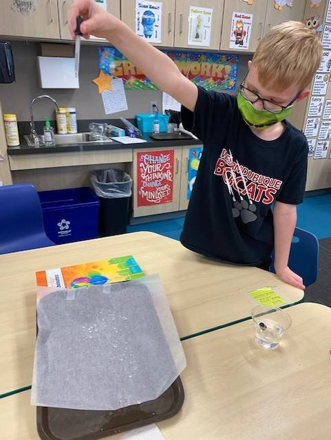3rd Grade student working on science experiment