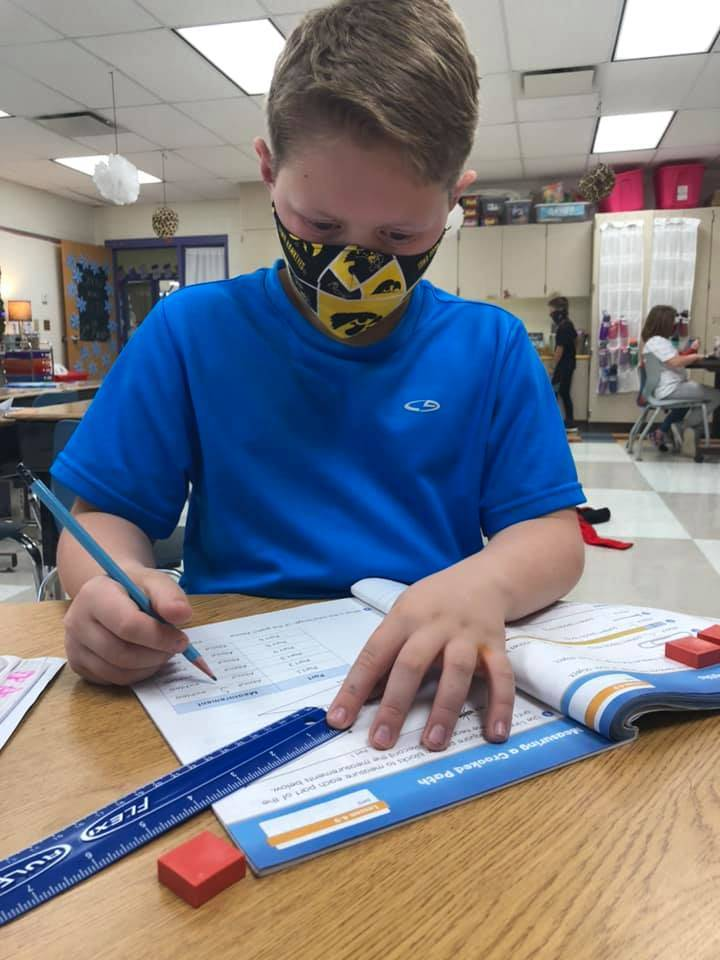 2nd grade student using ruler during math