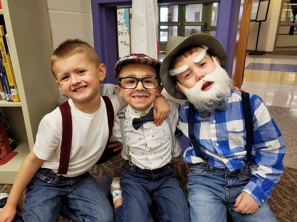 Three kindergarten boys dressed up as 100 years old
