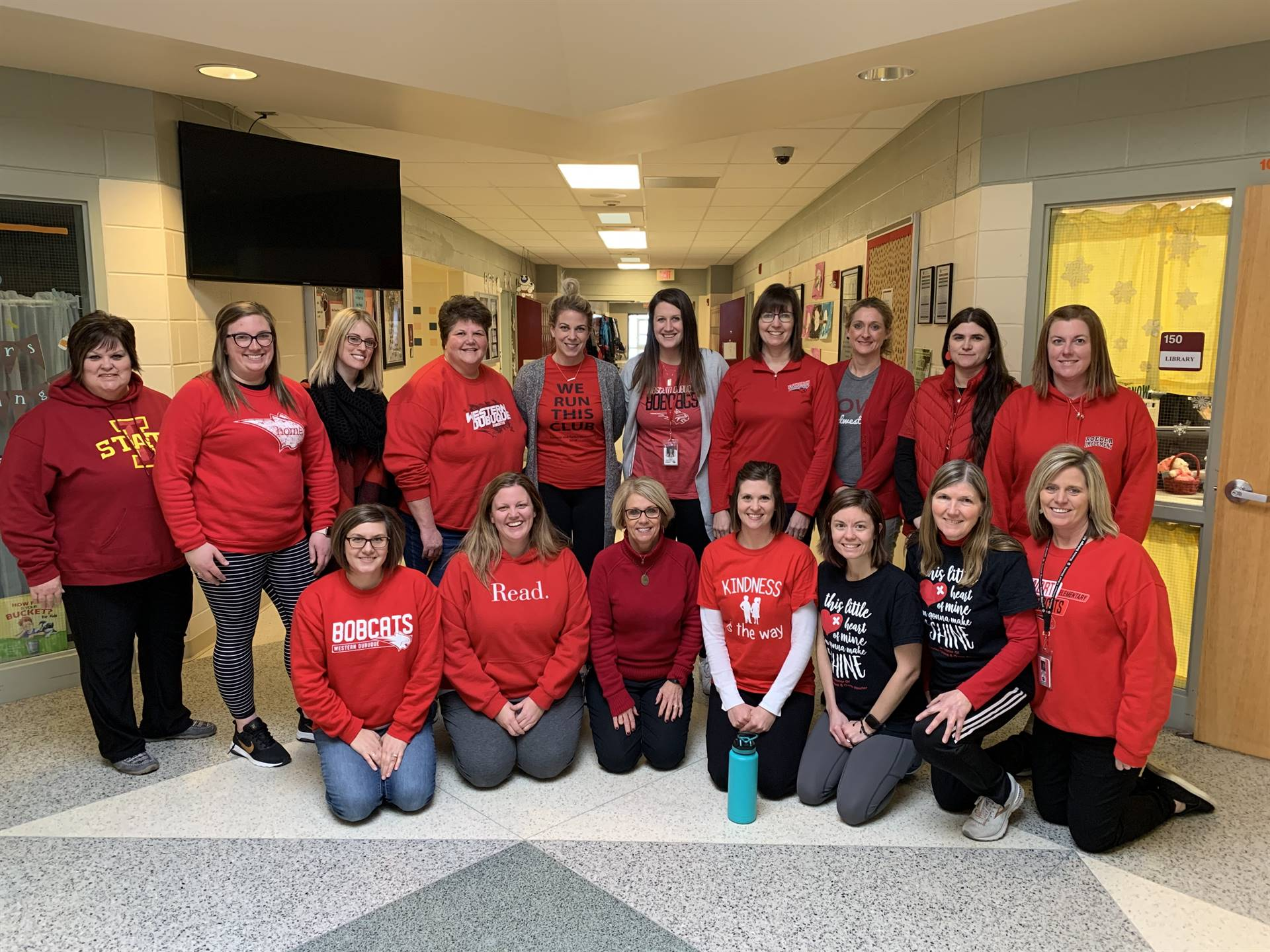 Staff wears red to support a local family