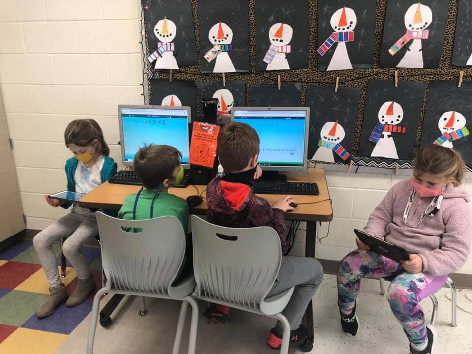 Second grade students working with technology