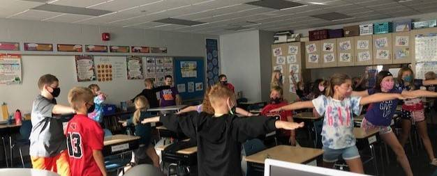 4th Grade students participating in yoga